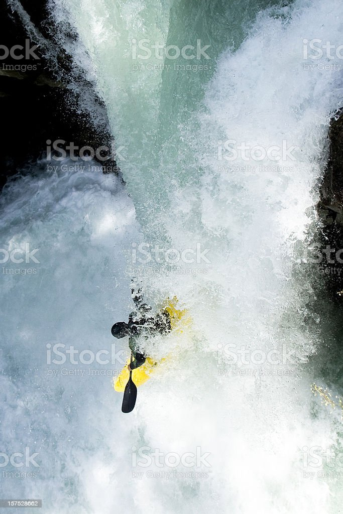 Kayaker dropping the waterfall. stock photo
