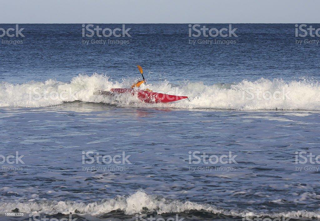 Kayaker in rough sea royalty-free stock photo