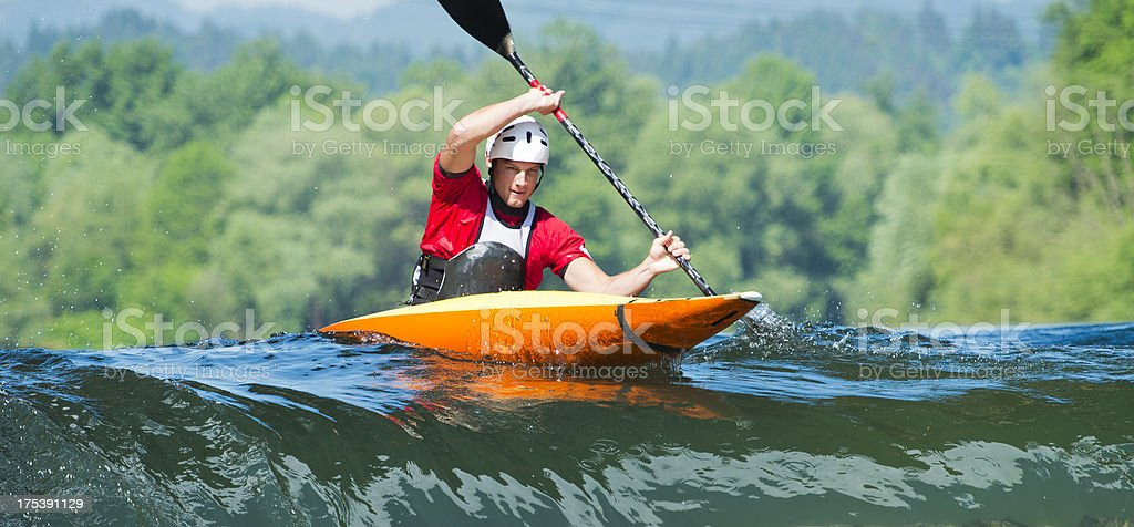 Kayaker in the action stock photo