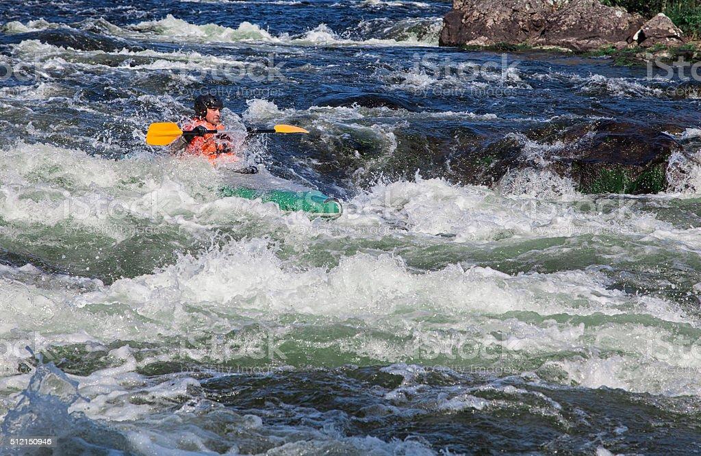 Kayaker in whitewater stock photo