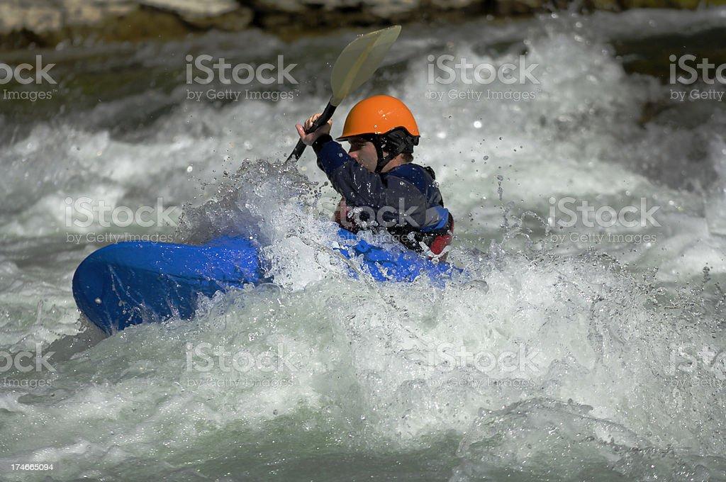 Kayaker navigates through the white water rapids royalty-free stock photo