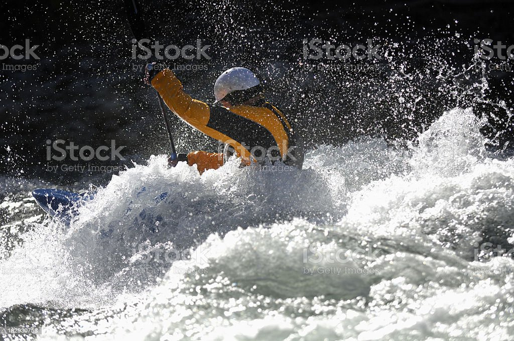 Kayaker navigates through the white water rapids royalty-free stock photo