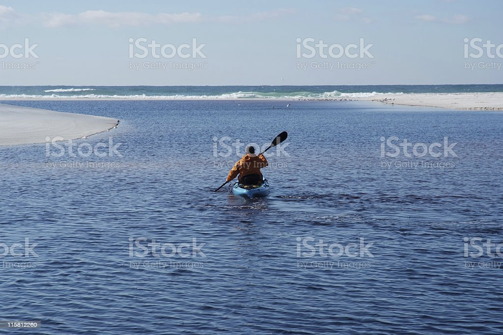 Kayaker Paddling in Water - Coastal Florida Lake royalty-free stock photo