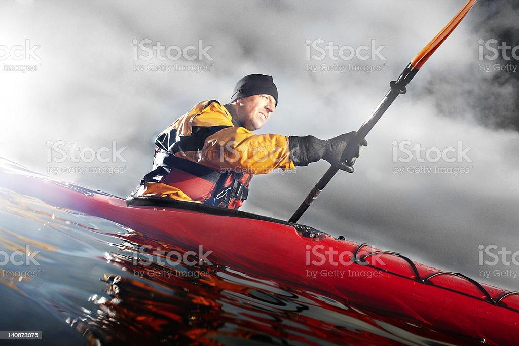 Kayaker paddling in water stock photo