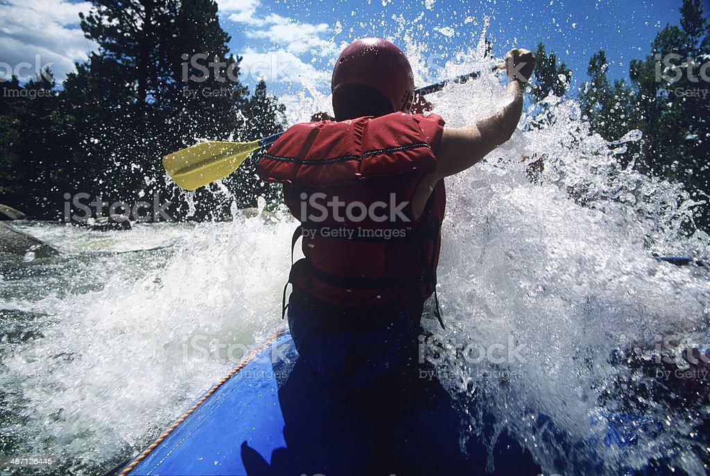 Kayaker Paddling Through Rapids stock photo