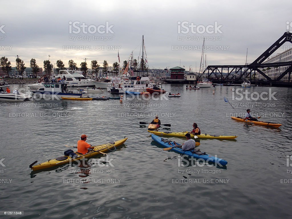 kayaker sit in McCovey Cove having fun waiting for balls stock photo