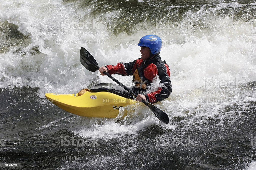Kayaker Surfing River Wave royalty-free stock photo