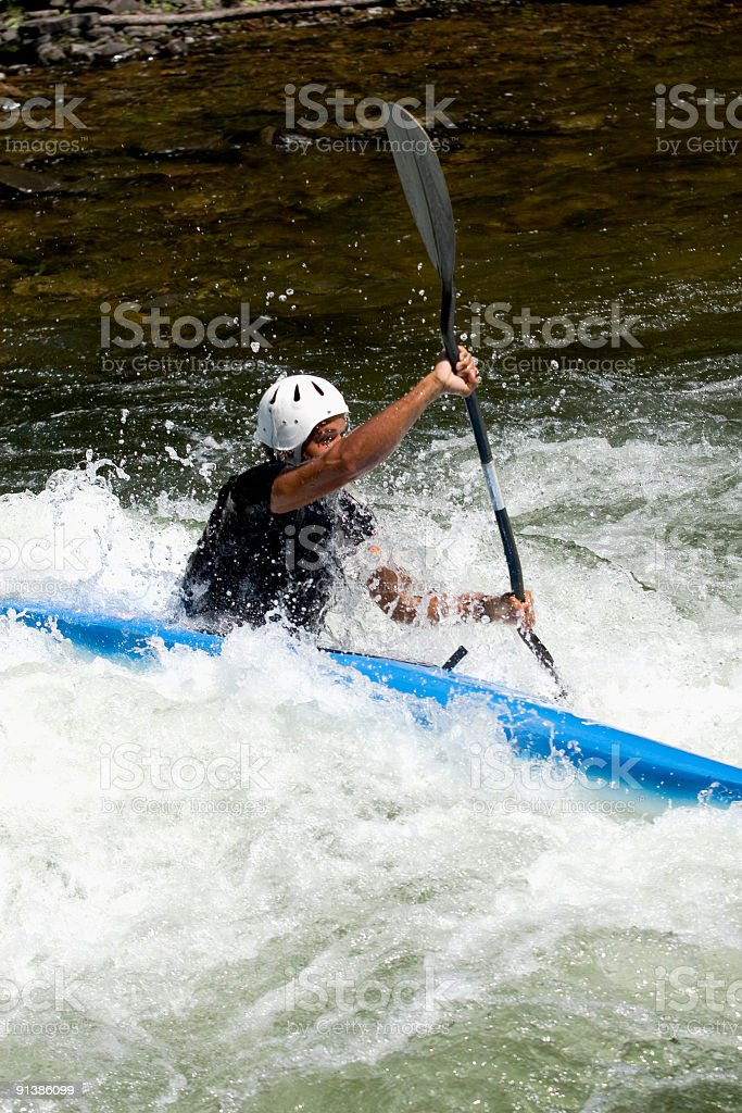 Kayaker with oar royalty-free stock photo