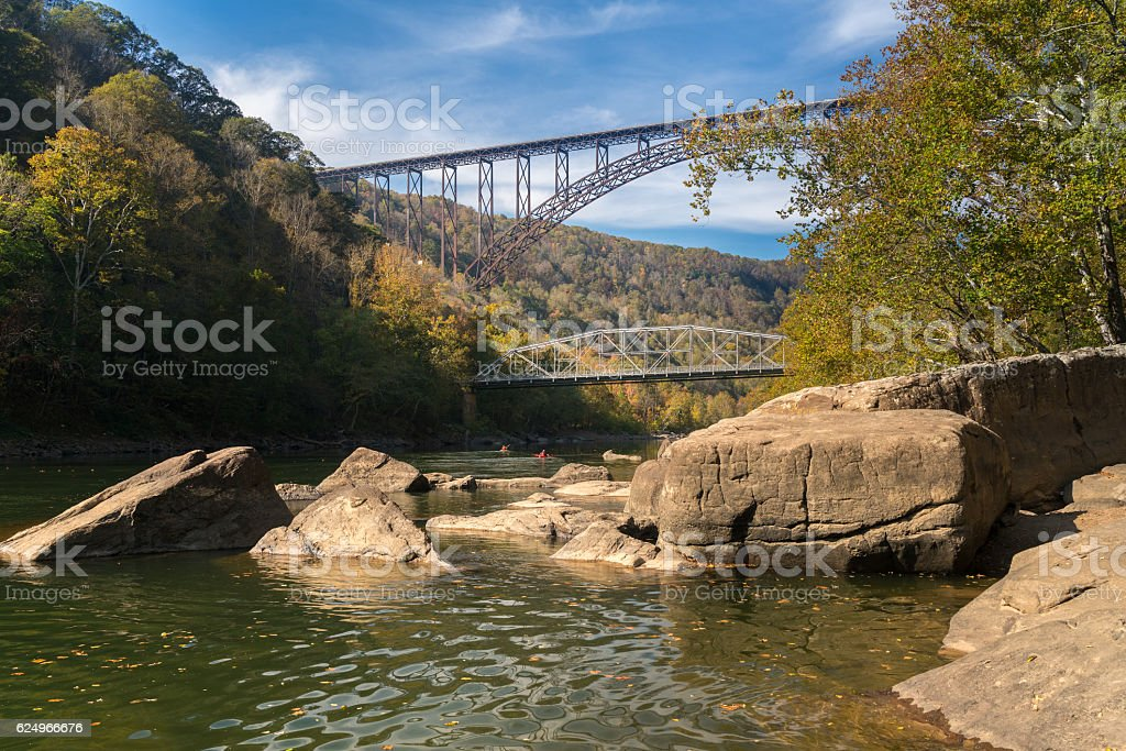 Kayakers at the New River Gorge Bridge in West Virginia stock photo