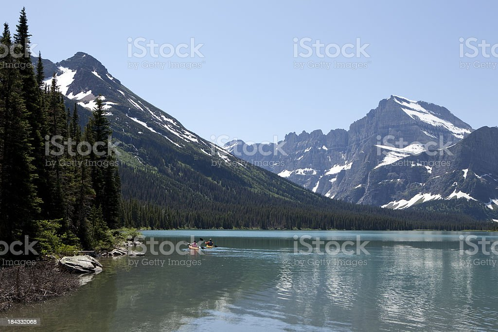 Kayakers in Lake Josephine with Mount Gould Glacier National Park stock photo