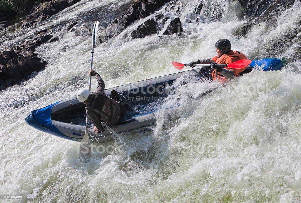 Kayakers in whitewater stock photo