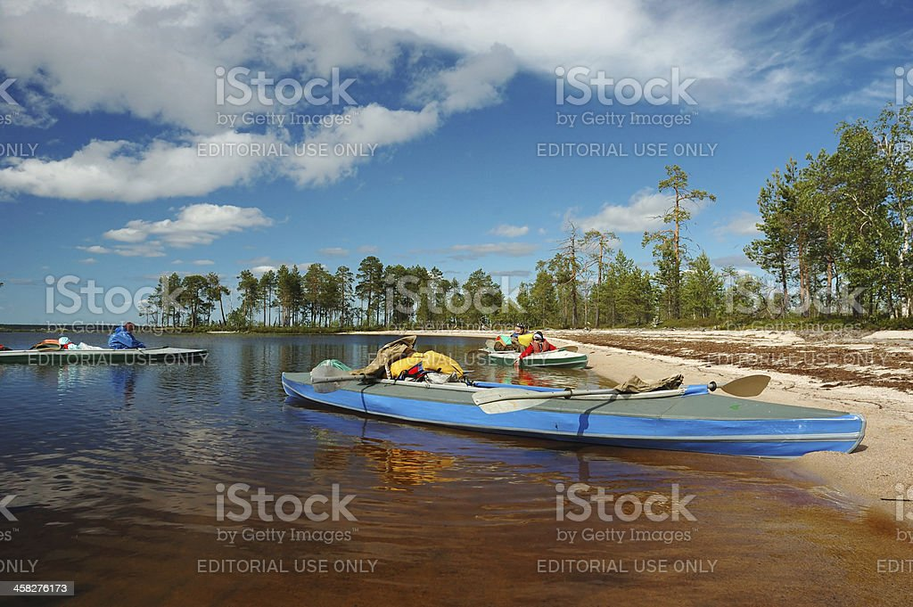 Kayakers mooring to wild island during sport competition, Karelia,Russia royalty-free stock photo