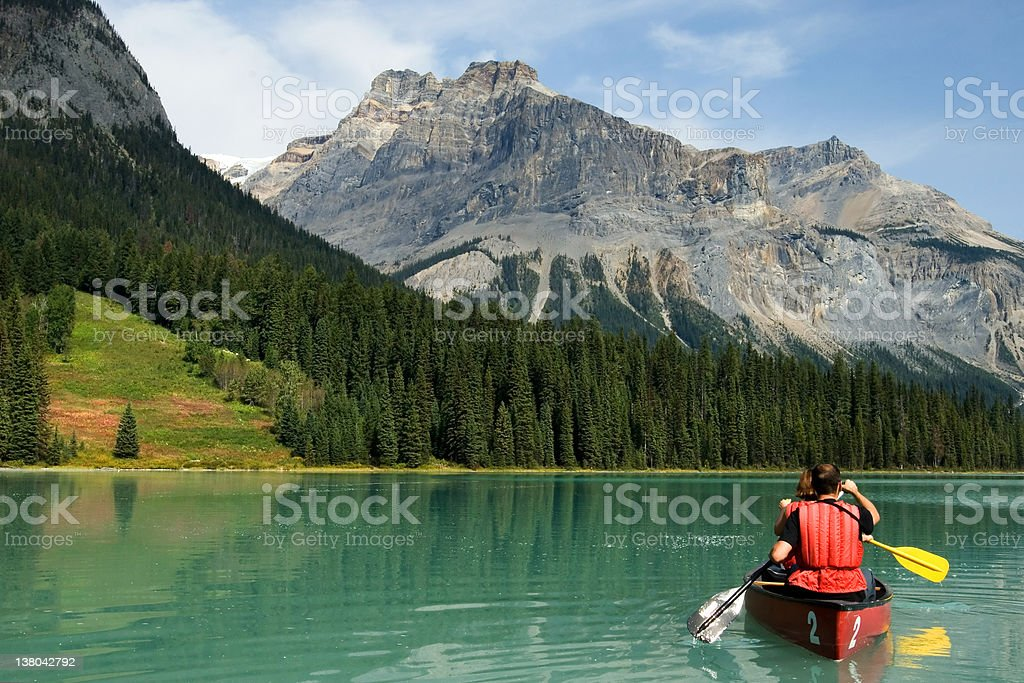 Kayakers on Emerald Lake in Yoho National Park stock photo