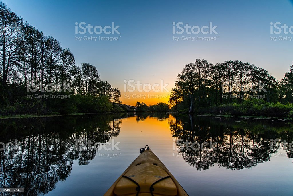 Kayaking at sunrise stock photo