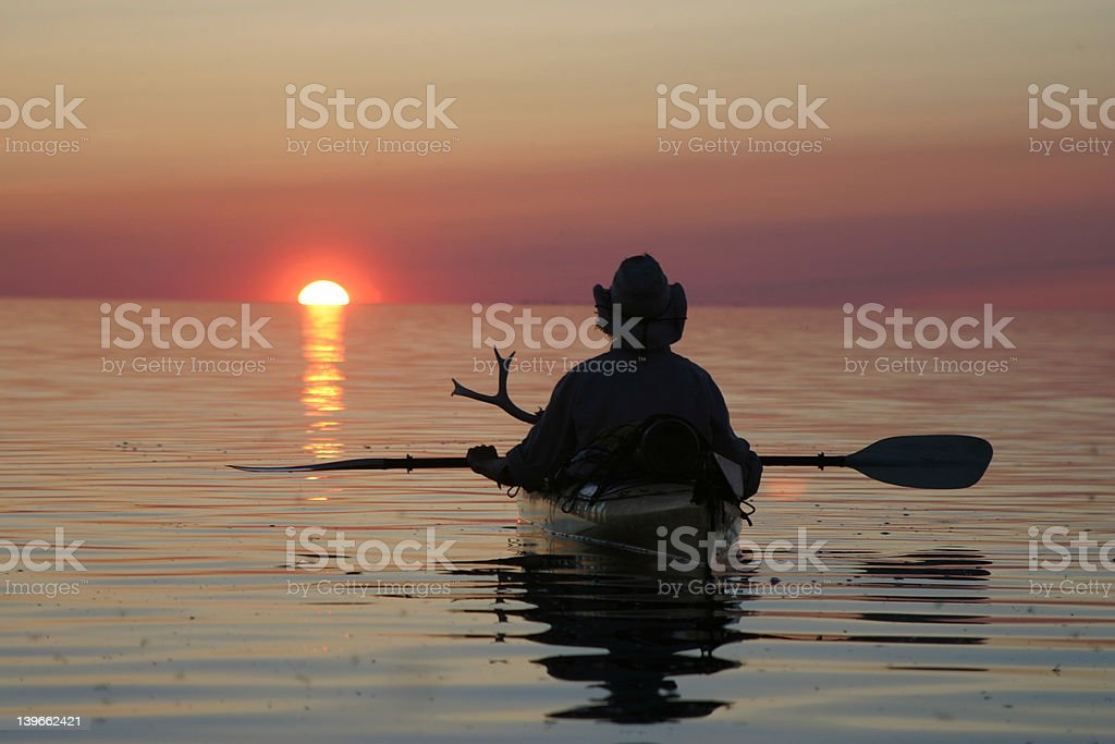 Kayaking at Sunset royalty-free stock photo