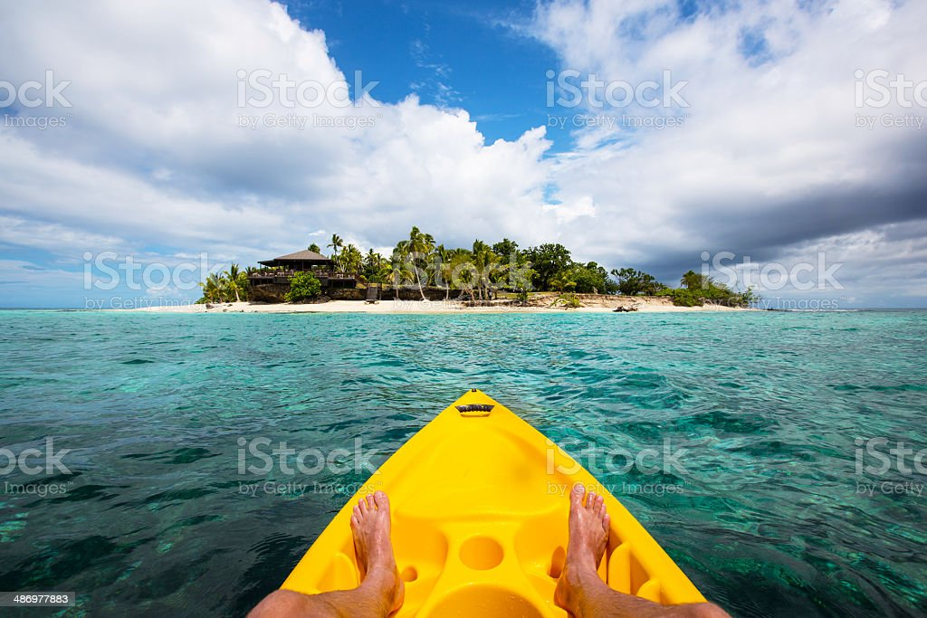 Kayaking by a tropical island in Fiji stock photo