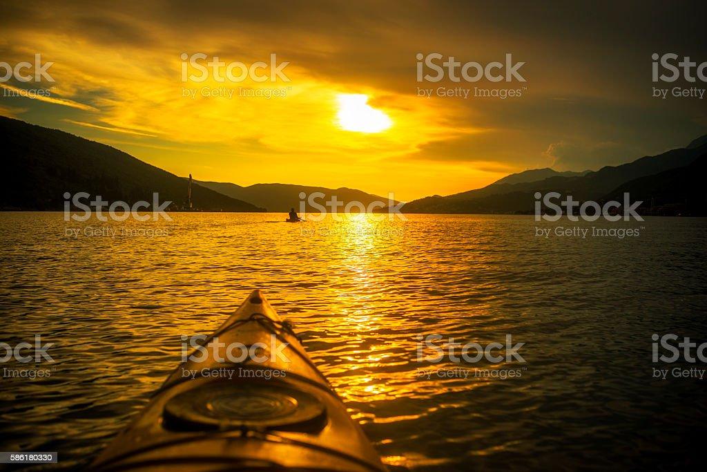 Kayaking by the Sunset. Bay of Kotor stock photo