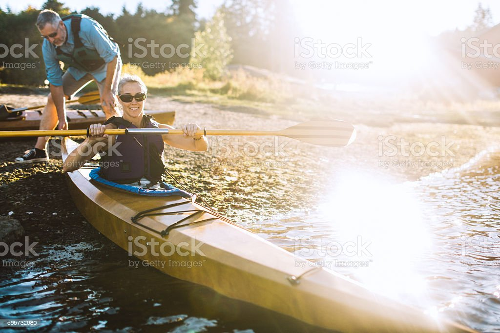 Kayaking Couple In The Pacific Northwest stock photo