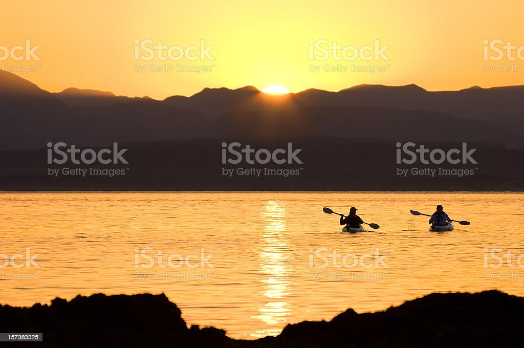 Kayaking Couple Pacific Sunset royalty-free stock photo