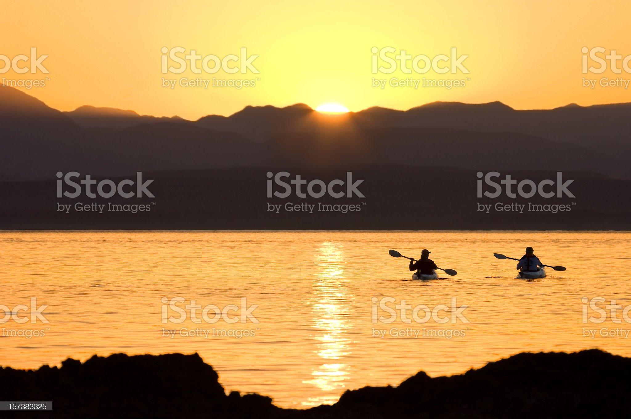 Kayaking Couple Pacific Sunset royalty-free stock photo