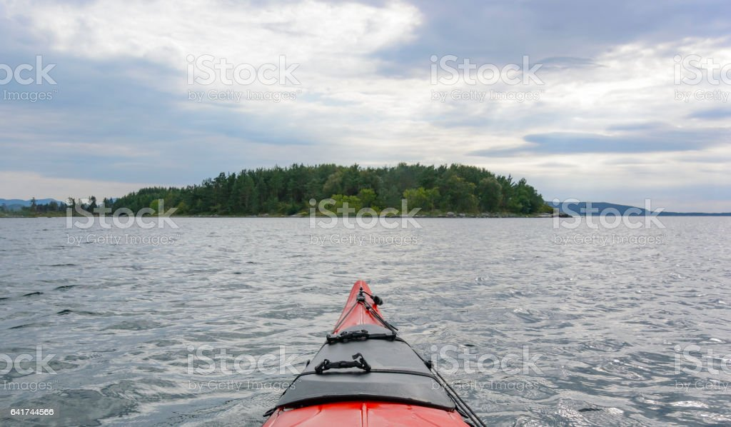 Kayaking in a Fjord in Norway during summer stock photo