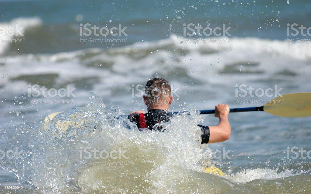 Kayaking in surf royalty-free stock photo