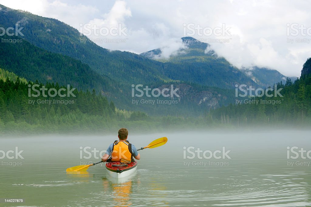 Kayaking in the river by the mountains stock photo