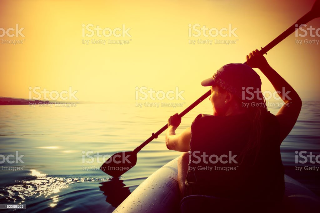 Kayaking in the sunset stock photo