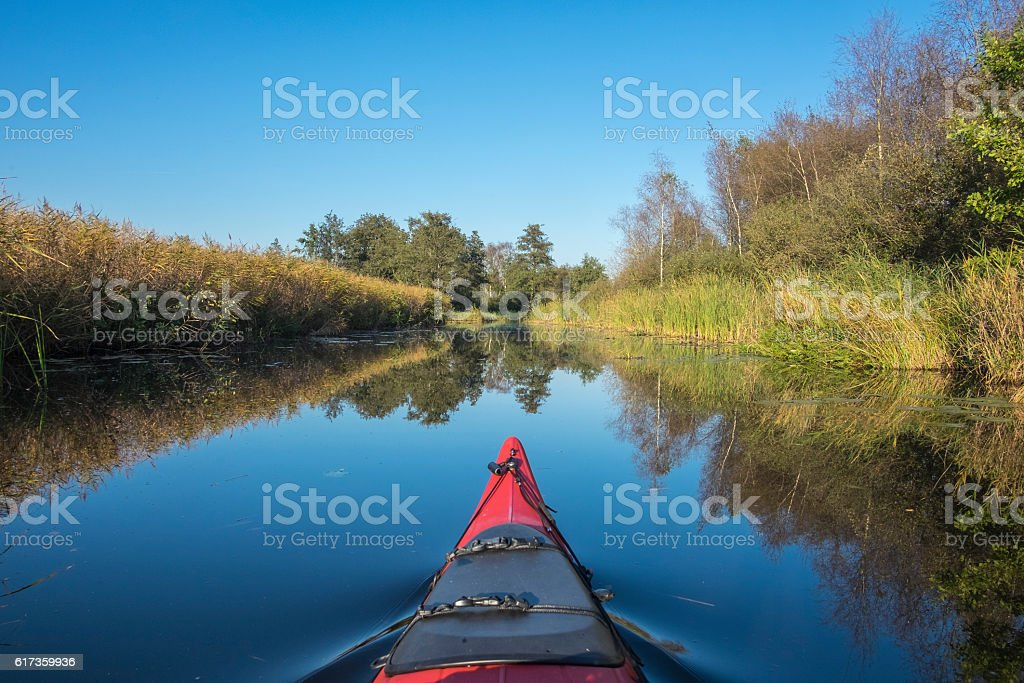 Kayaking in the Weerribben-Wieden nature reserve during a beauti stock photo