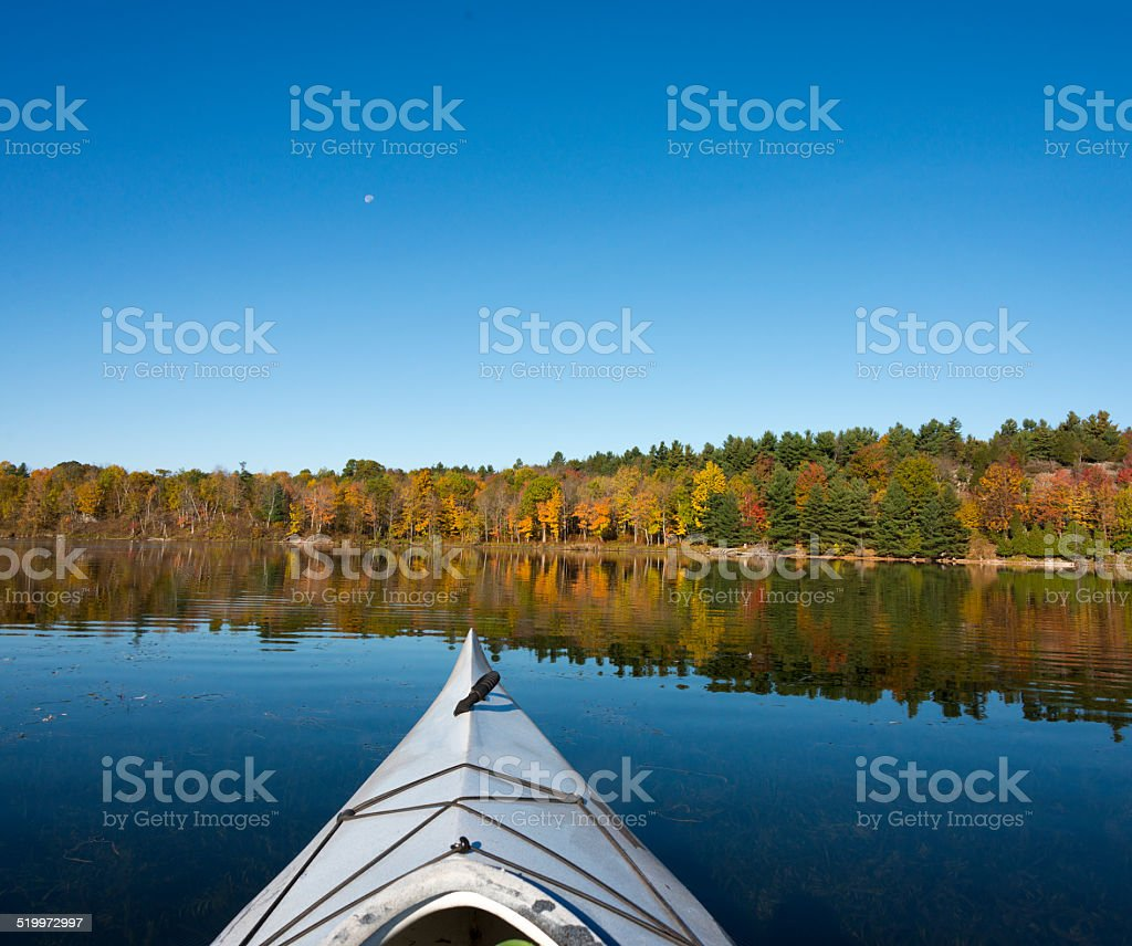 Kayaking on a Northern Lake in Autumn stock photo