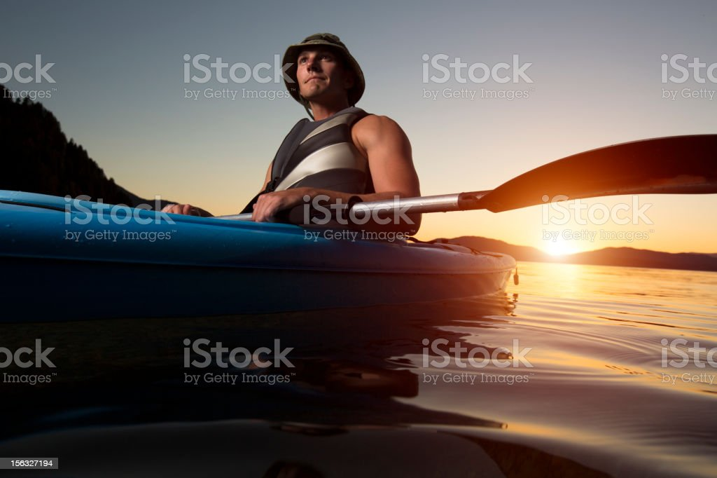Kayaking on a river at sunset stock photo
