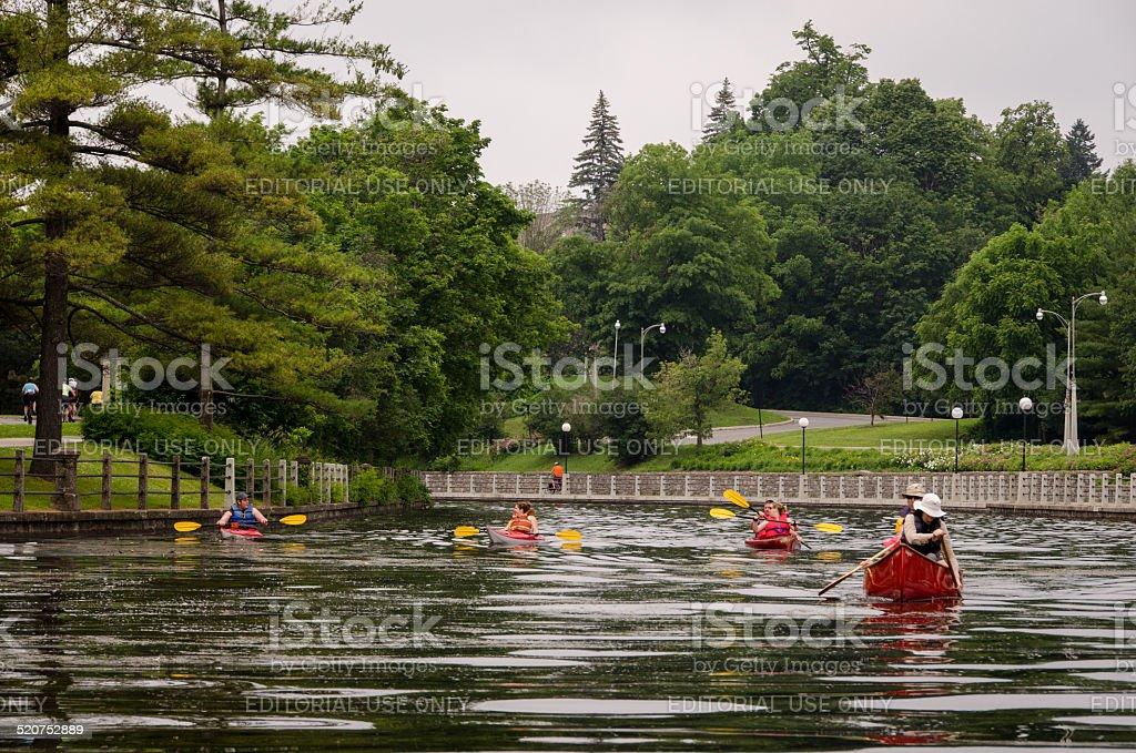 Kayaking on Ottawa's Rideau Canal (UNESCO World Heritage Site) stock photo