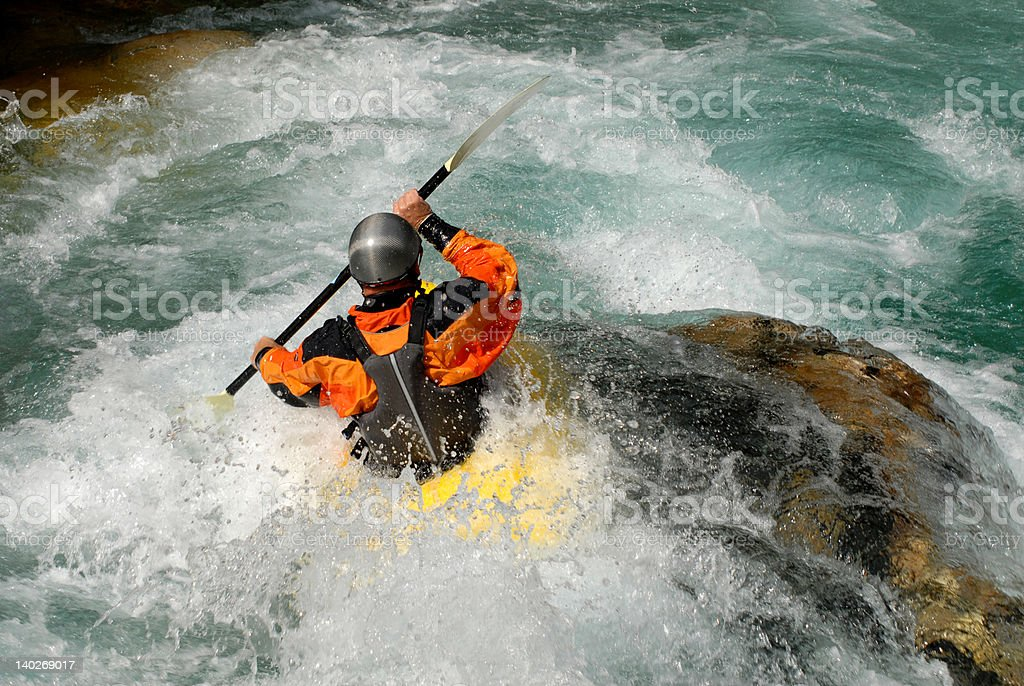 Kayaking on the rapids of river royalty-free stock photo