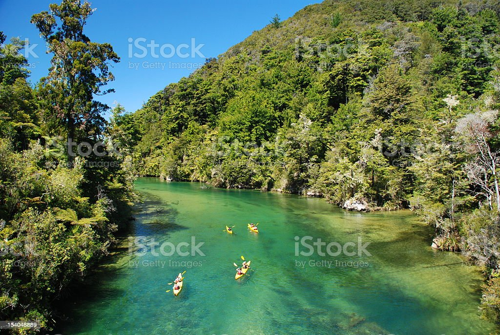 Kayaking over clear river water stock photo