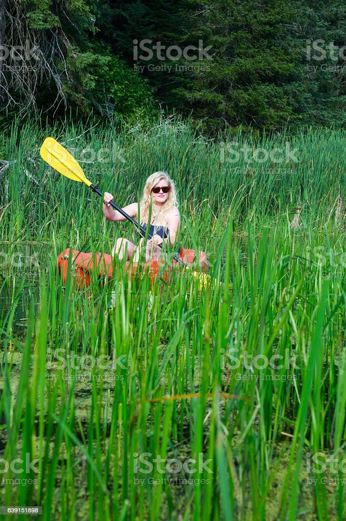 Kayaking through a wild river stock photo