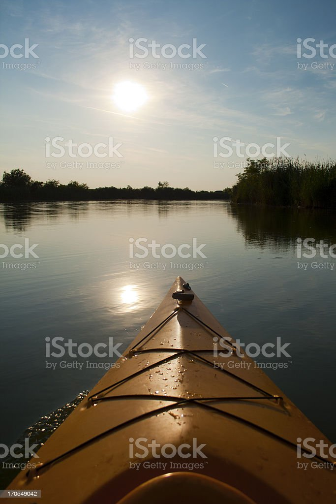 Kayaking toward sun royalty-free stock photo
