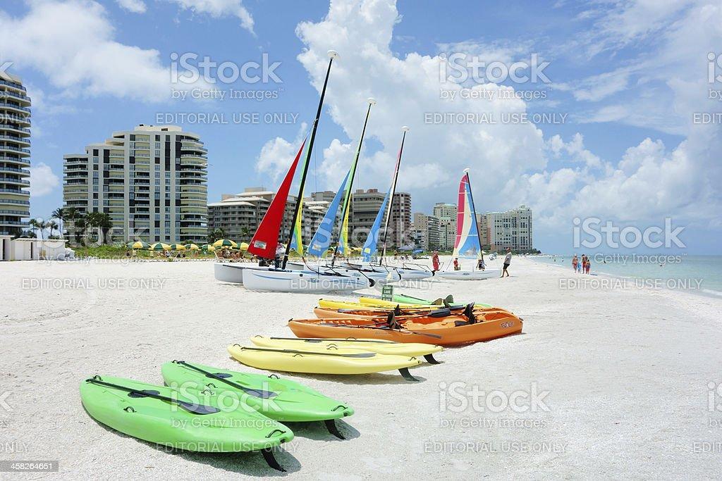 Kayaks and Hobie catamarans on beach royalty-free stock photo
