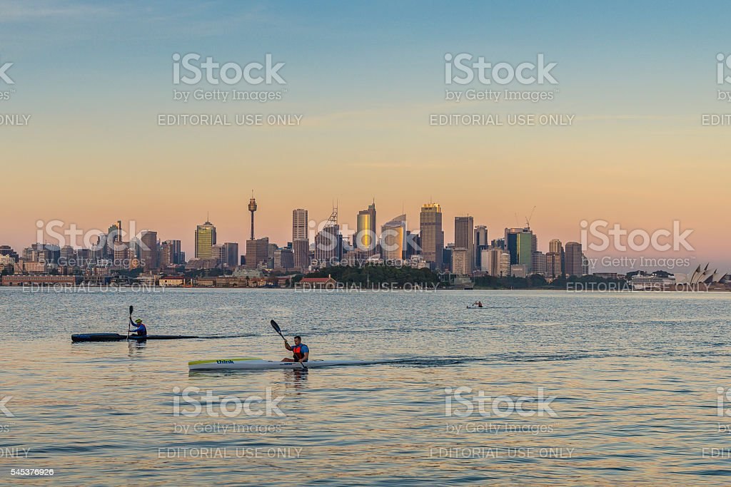 Kayaks and Sydney Cityscape, Australia at golden dawn stock photo