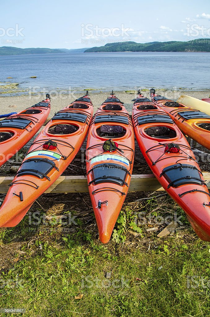 Kayaks by the lake stock photo
