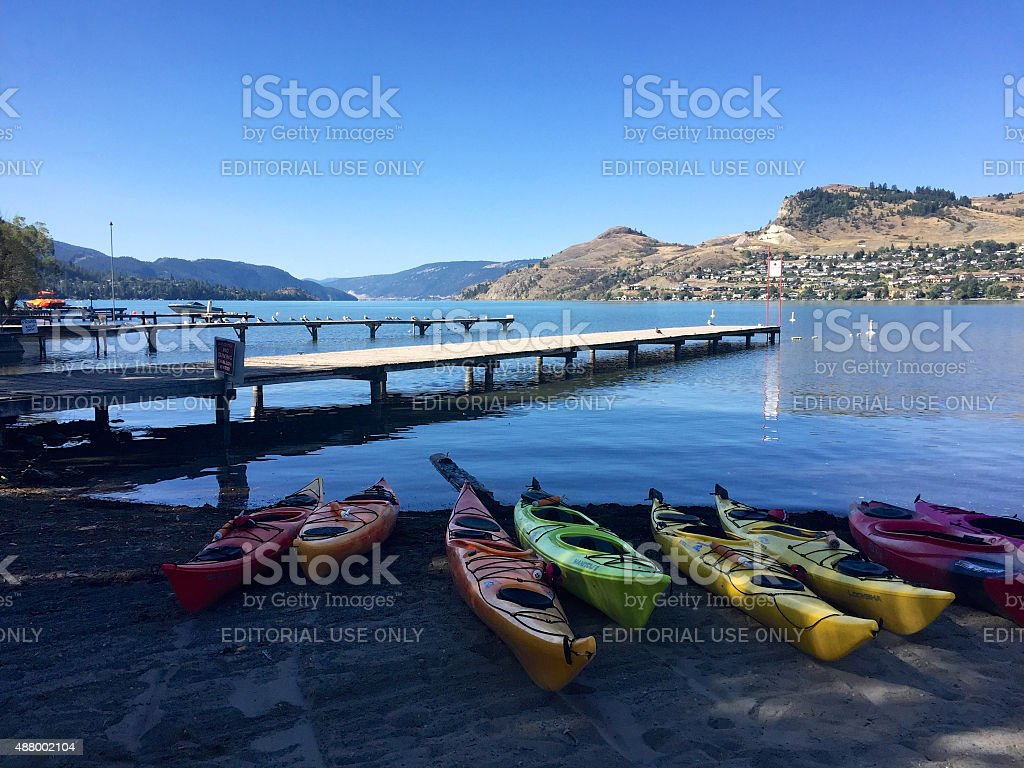 Kayaks on beach at Kalamalka Lake, Vernon, British Columbia, Canada stock photo