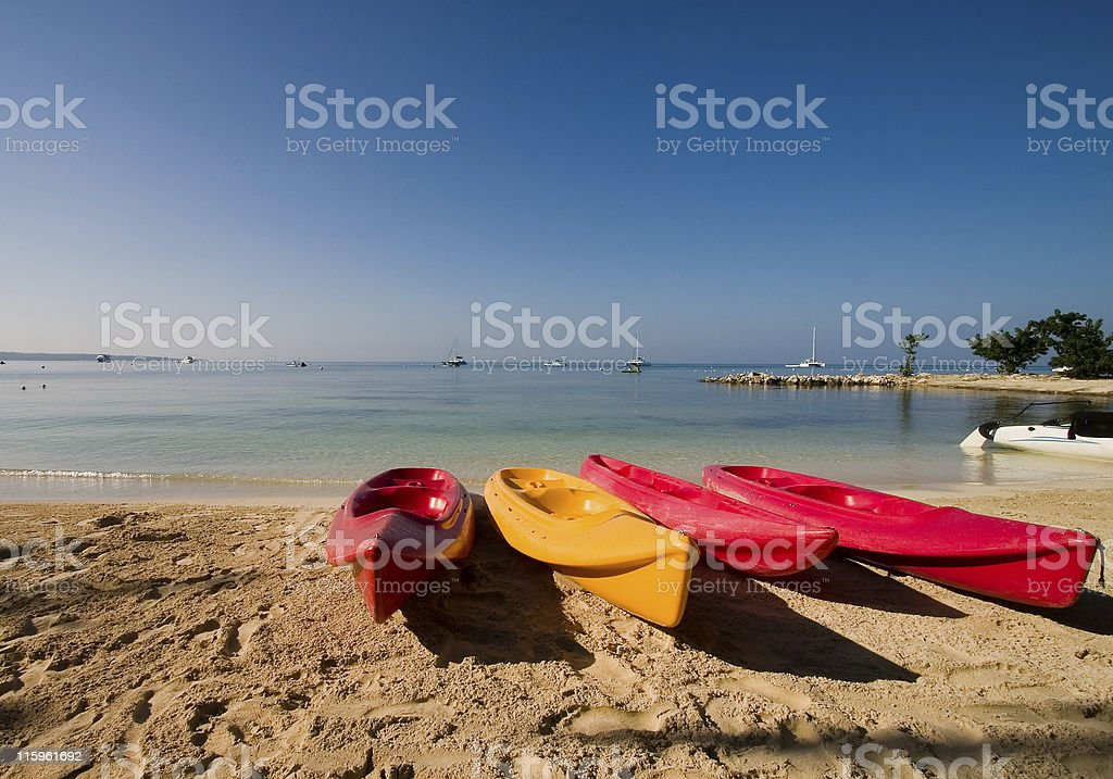 Kayaks on beach royalty-free stock photo