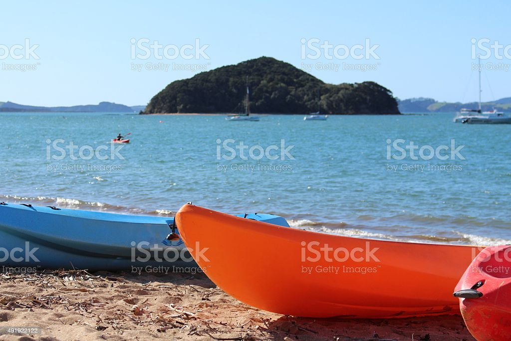Kayaks on the beach looking out to sea stock photo