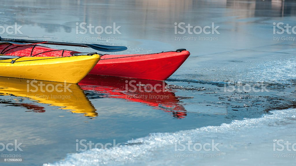 kayaks on the river ice, boat detail stock photo