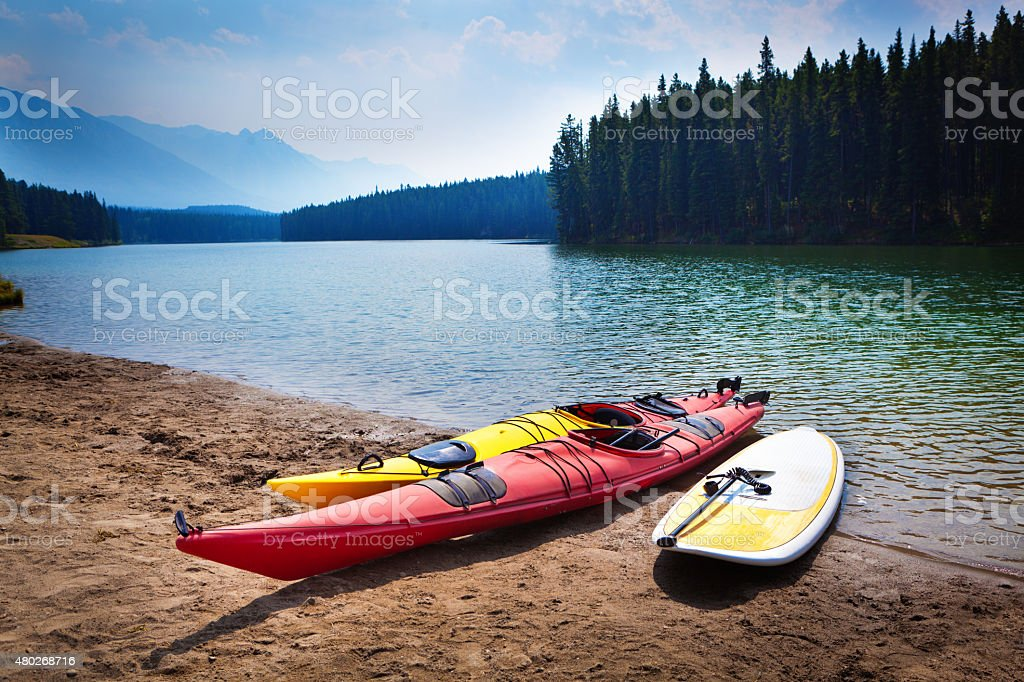 Kayaks Paddle Board in Johnson Lakes of Banff National Park stock photo
