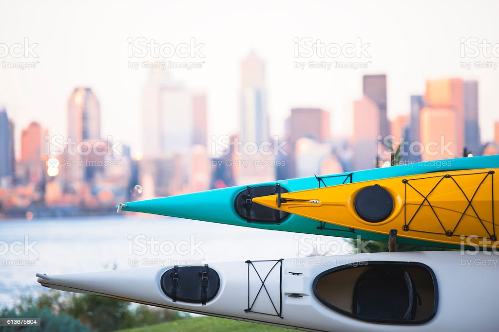 Kayaks stacked on rack on background of Seattle downtown stock photo