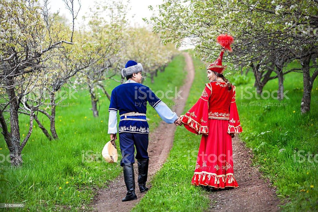 Kazakh couple in the garden stock photo