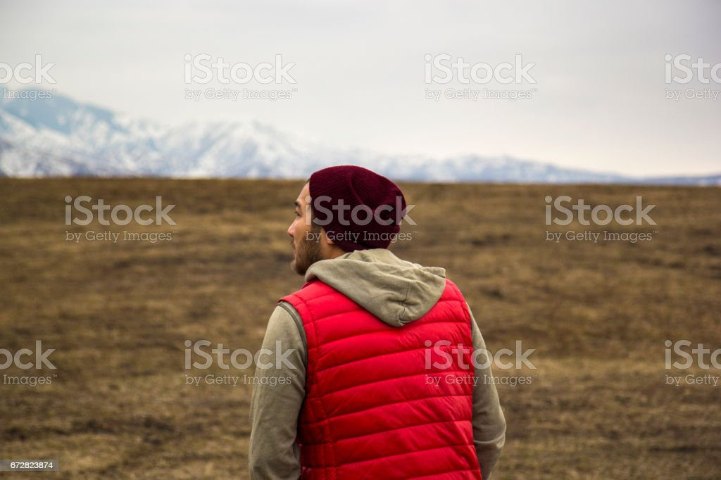 Kazakh man in red waistcoat on the mountains background stock photo