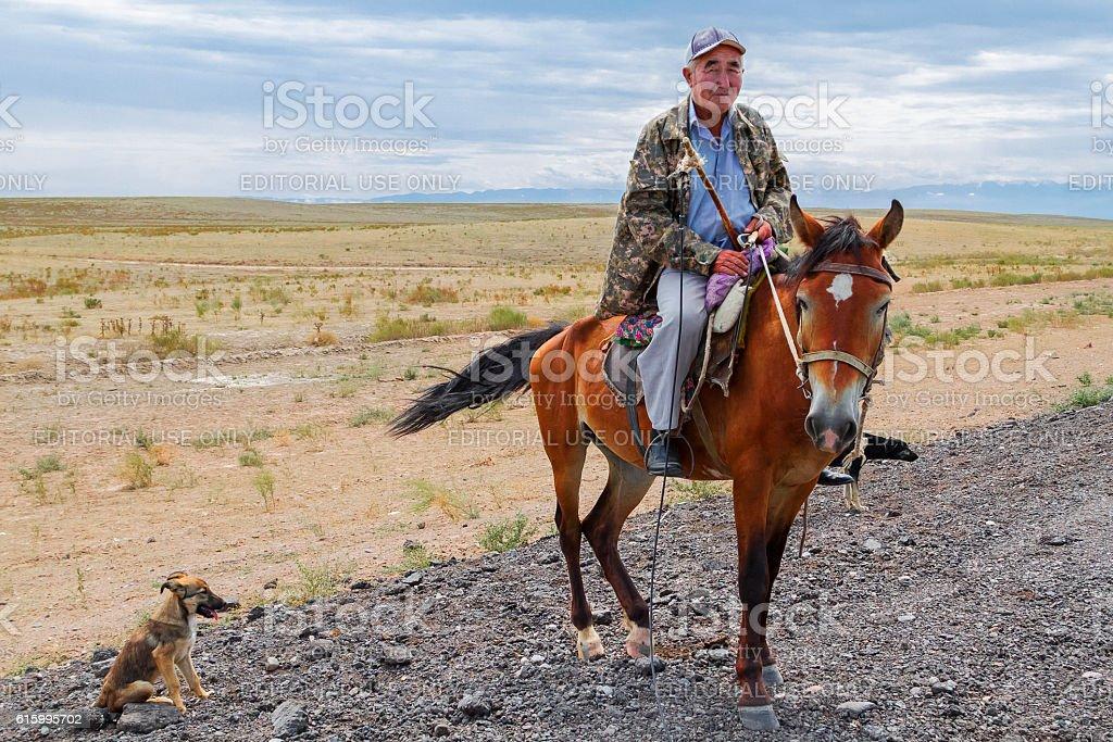Kazakh man on his horse stock photo