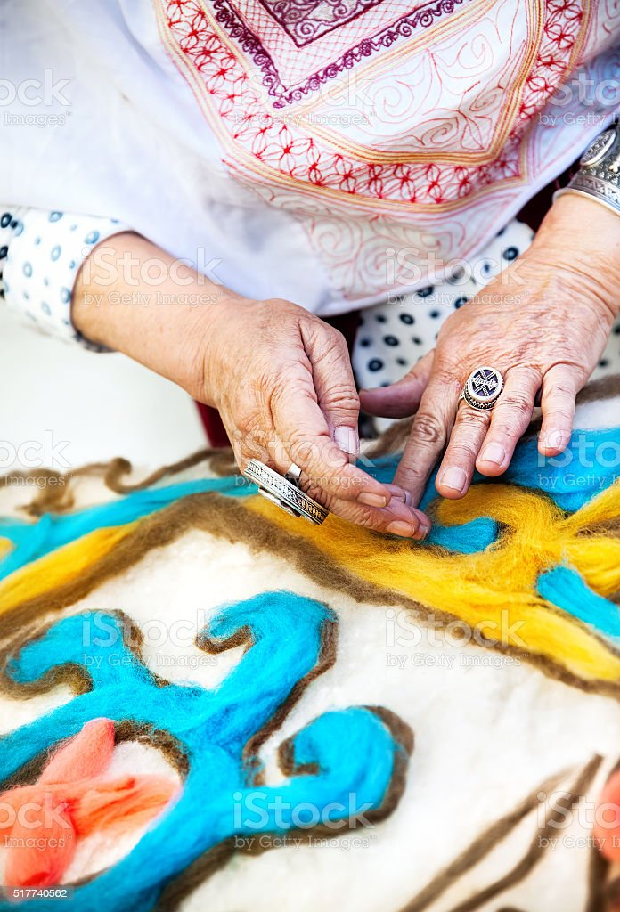 Kazakh woman making pattern stock photo