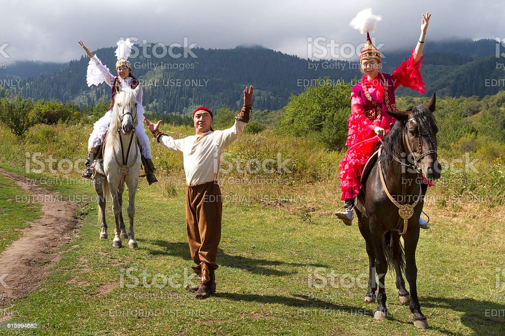 Kazakh women and man in national costumes. stock photo